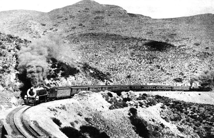 The railway overcomes the slopes of the mighty Matrooseberg by means of the Hex River Pass