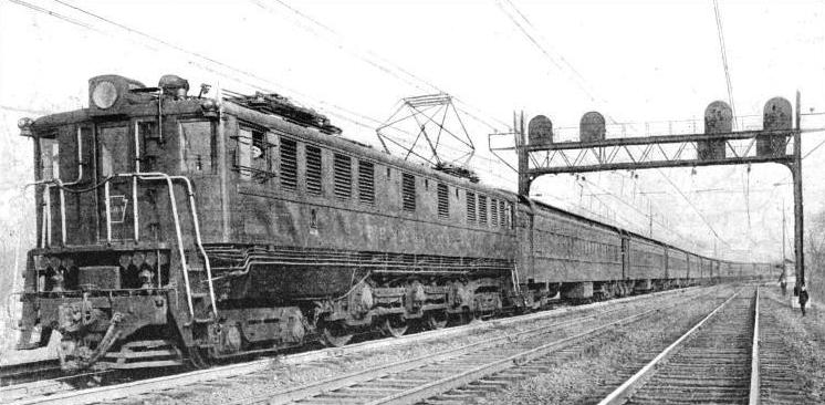 AN EXPRESS PASSENGER train of the Pennsylvania Railroad drawn by a modern electric locomotive
