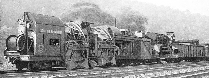a machine in action renewing ballast on the lines of the Pennsylvania Railroad
