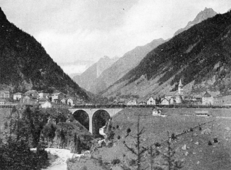GÖSCHENEN, a small Swiss town 3,640 ft above sea level, which stands at the northern portal of the famous St. Gothard Tunnel