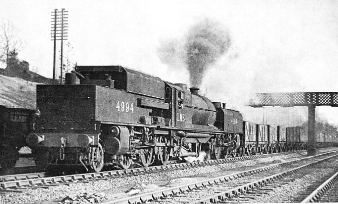 "MODERN ""BEYER-GARRATT"" articulated engine of the 2-6-0 + 0-6-2 type, hauling a coal train on the LMS line"