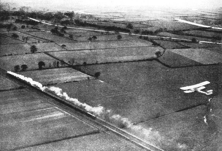 "the ""Flying Scotsman"" accompanied on its northward journey by the Imperial Airways liner, ""Heracles"""