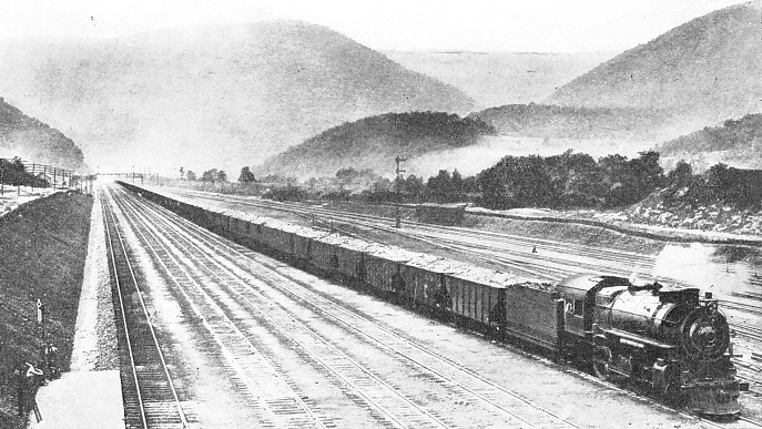 A LONG FREIGHT TRAIN of one hundred coal wagons on the Middle Division of the Pennsylvania Railroad system