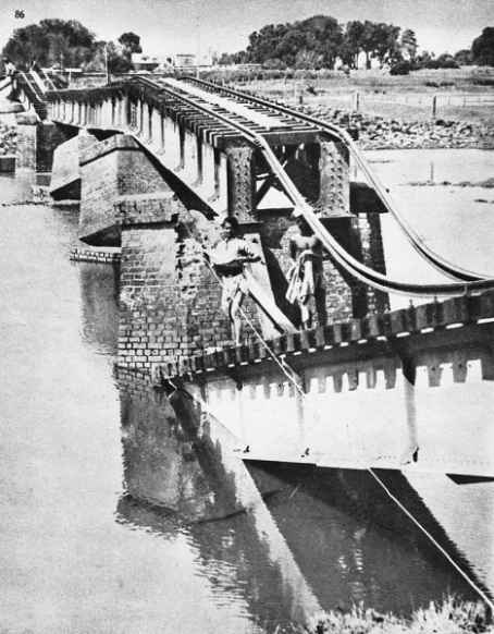 This picture graphically illustrates the destruction of a railway bridge near Sitamarhi in India, during the great earthquake of 1934