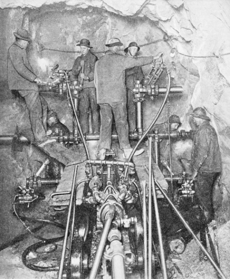 A working face, showing a powerful drilling machine in action during the boring of the great Cascade Tunnel
