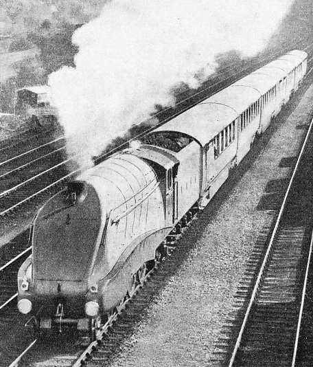 "A remarkable photograph of the ""Silver Jubilee"" climbing past New Barnet at a speed of nearly 75 miles an hour during the Experimental run"