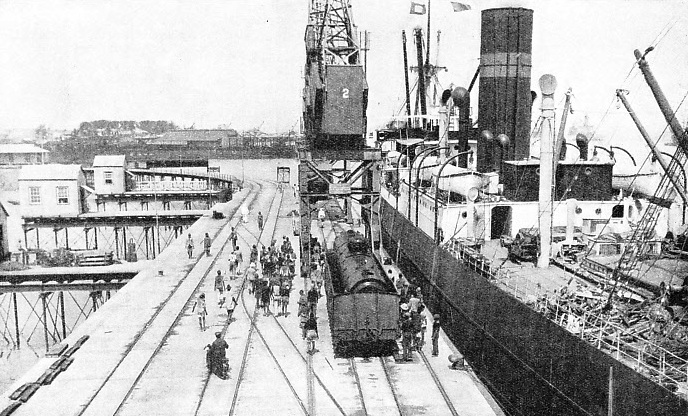 UNLOADING A LOCOMOTIVE from the SS Clan Mackenzie for the Rhodesia Railways