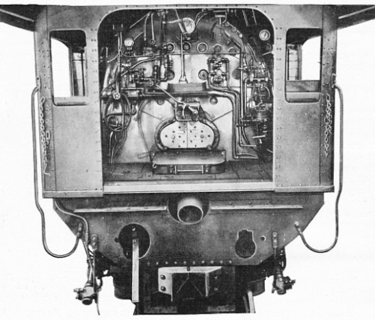 LOCOMOTIVE CAB SHOWING ELVIN STOKER IN POSITION