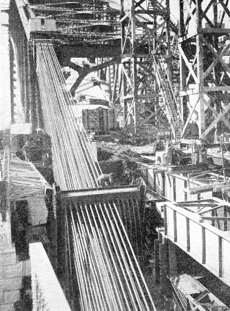 ANCHORAGE ROPES being dismantled at the South Pylon after the closing of the main arch