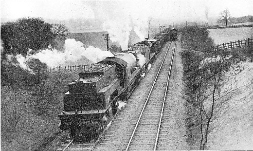 """BANKING"" A HEAVY COAL TRAIN UP A 1 IN 40 GRADIENT ON THE LNER"