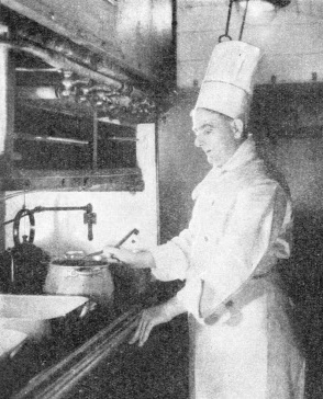 The Chef of the train preparing a meal